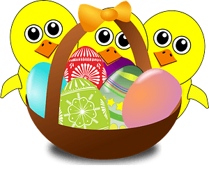Funny chicks cartoon with easter eggs in a basket clipart