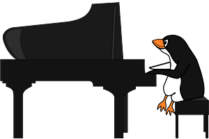 Penguin playing the piano clipart