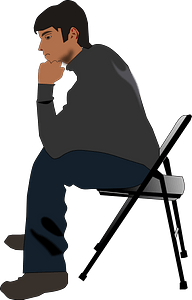 Man Sitting on a Folding Chair Thinking clipart