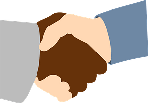 Handshake between African and Caucasian clipart