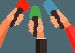 Reporters' Hands Holding Microphones clipart