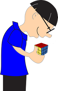 Boy playing with a magic cube clipart