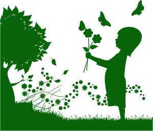 Girl with flowers in a garden silhouette